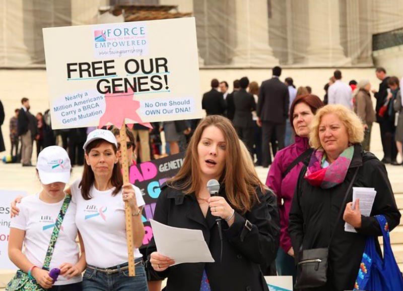 Demonstrators on the steps of the Supreme Court on the morning of oral arguments in Association for Molecular Pathology v. Myriad Genetics (Apr. 15, 2013)